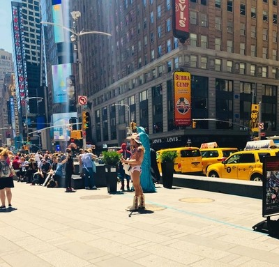 Everyone loves Naked Cowboy in Time Square In New York City