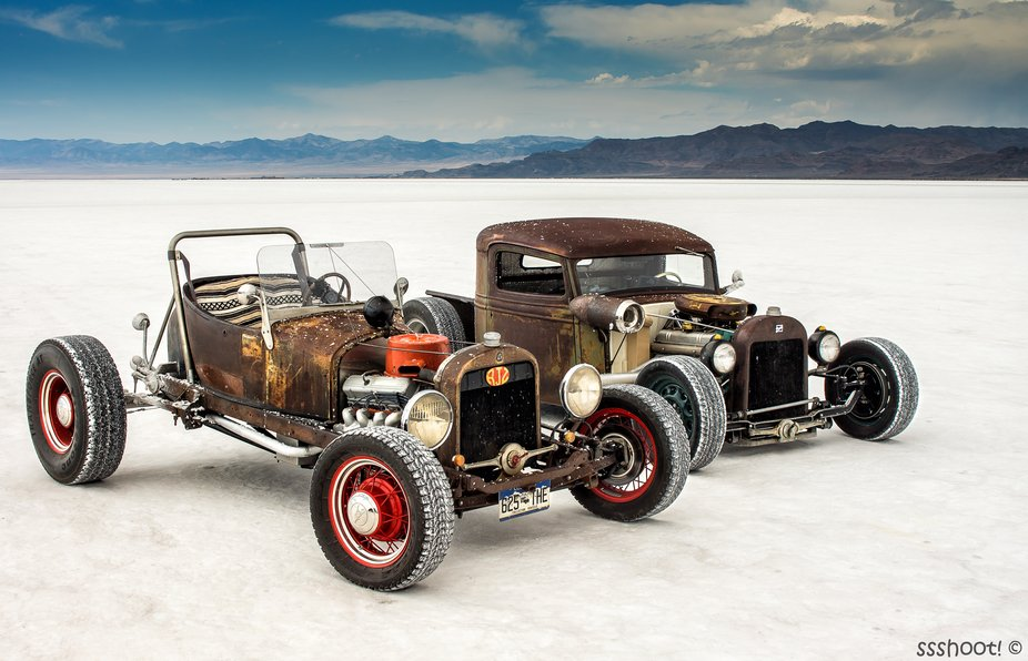 A couple of rat rods parked up on Bonneville Salt Flats, Utah during the SCTA Speedweek land spee...