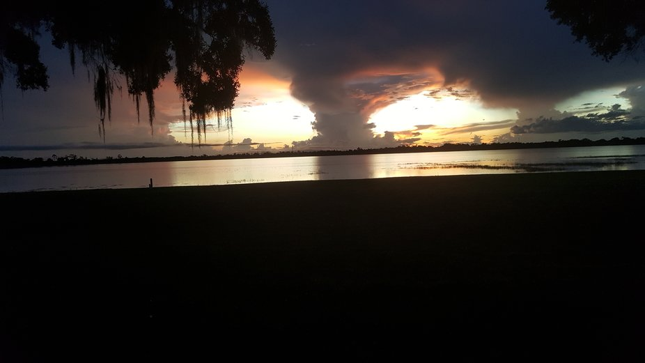 Sunset after thunderstorm on Lake Letta in Avon Park Florida. This was taken in my back lawn.Terr...