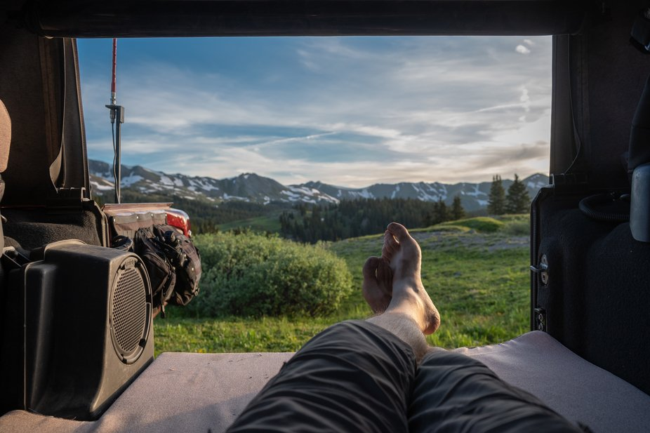Settling in for bed in the back of our Jeep, high up in the Rockies. The air was thin, but the views were some of the most breathtaking we've experienced.