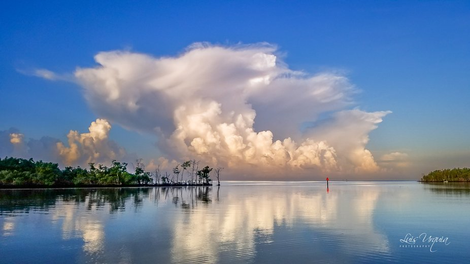 Summer storms to my west in the Gulf of Mexico with added super calm wind creating  incredible co...