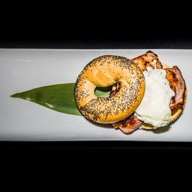 a tasty breakfast bagel filled with egg, sausage and bacon to start the day