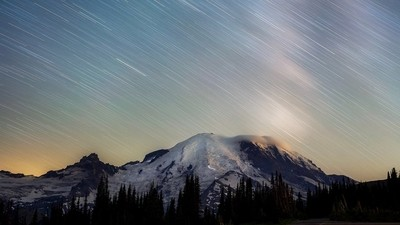 Mount ranier star trails in this 20 minute single exposure. You can see the hikers ascending the mountain in the light trials.