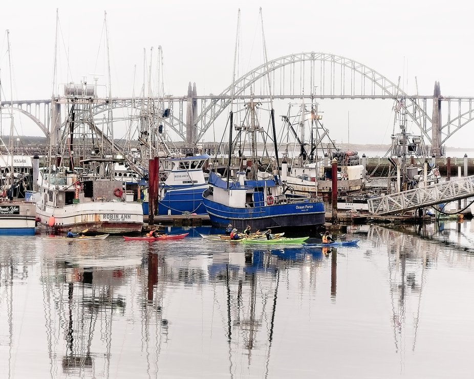 Fishing boats at dock in Yaquina Bay in Newport, Oregon.