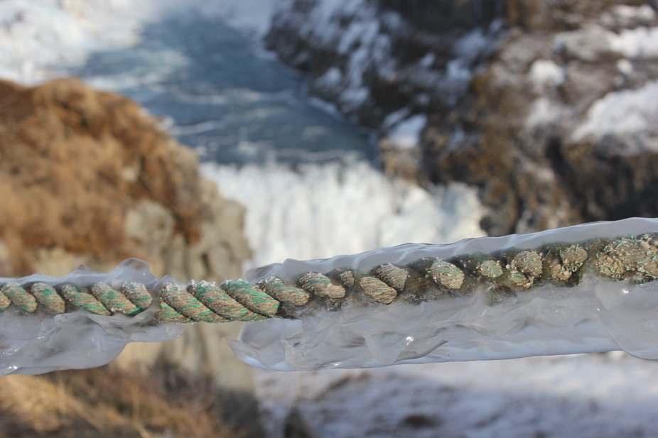Frozen rope at an Icelandic waterfall