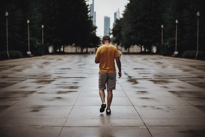 Man Walking In the City on a Rainy Day