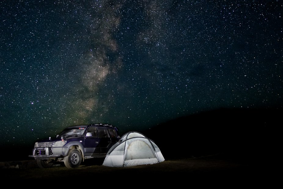 Camping astride Sheosar Lake, Deosai Plains - Roof of the World at an elevation of 13,589 ft with...