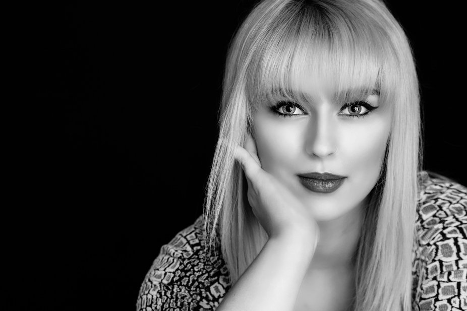 Blond young lady with brilliant make-up