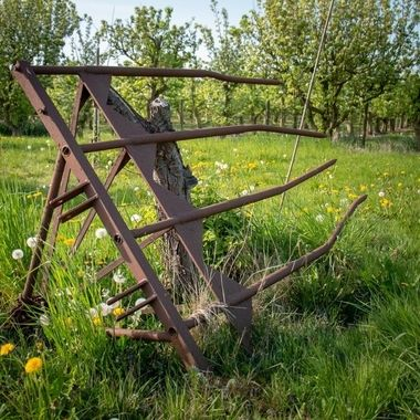 Old agricultural tool in a meadow in Woijdenes, Holland