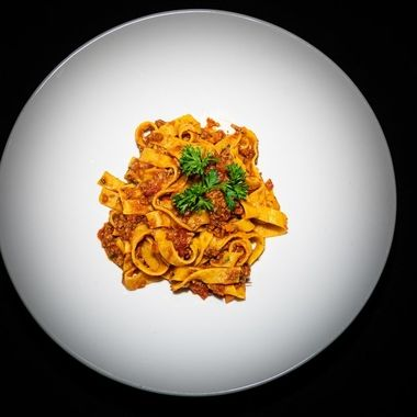 a tasty spicy pasta Bolognese served with fettuccini pasta