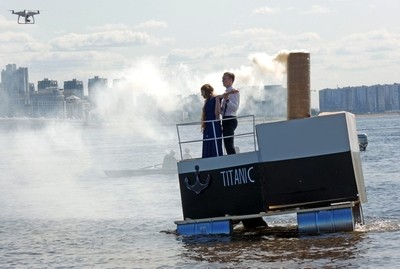 """The Team """"Titanic"""". Show """"Swim"""". All teams must sail on homemade floating structures. St. Petersburg, Park of the 300th anniversary of St. Petersburg. August 17, 2019. Photo 02."""