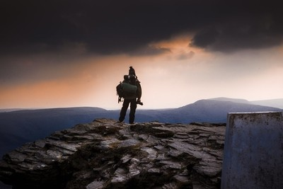 Photographer above the sea of clouds