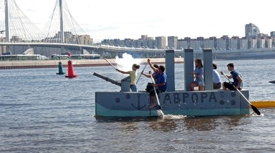 """The Team """"Cruiser Aurora"""". Show """"Swim"""". All teams must sail on homemade floating structures. St. Petersburg, Park of the 300th anniversary of St. Petersburg. August 17, 2019. Photo 03."""