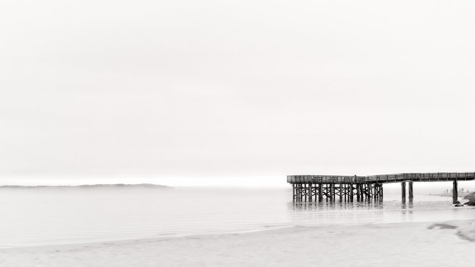 A lonely pier on a misty evening on the Oregon coast...