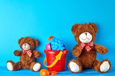 two brown teddy bears on a blue background, friendship concept