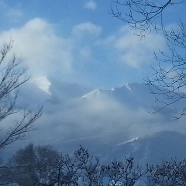 On a cold and snowy morning covered in fog, Mt. Princeton begins to show its majesty.