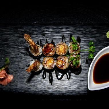 a tasty eight piece hosomaki tempura rolls drizzled with teriyaki sauce