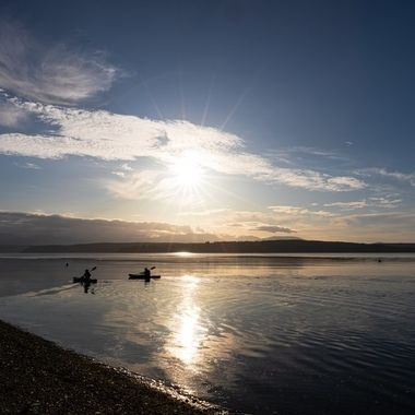 Some kayakers enjoying the evening on Hood Canal.
