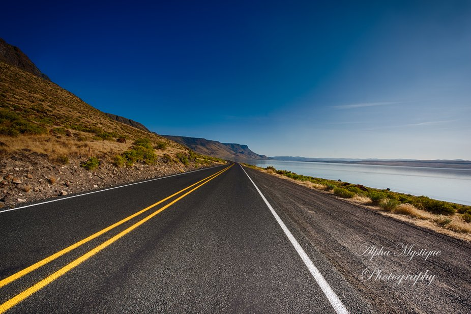 The highway next to Alkai Lake.  I recently took a road trip to expand my portfolio, and retrieve...