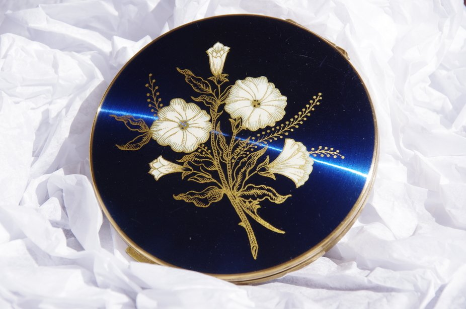 This powder compact was handed down to me by my mother.  She used it in her late teen years. It s...