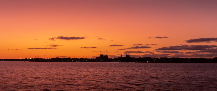 A view of Charlottetown, PE from across the harbour at sunset