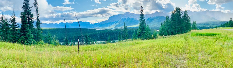 A scenic panoramic capture of the beautiful Canadian Mountains near Brule, Alberta Canada.