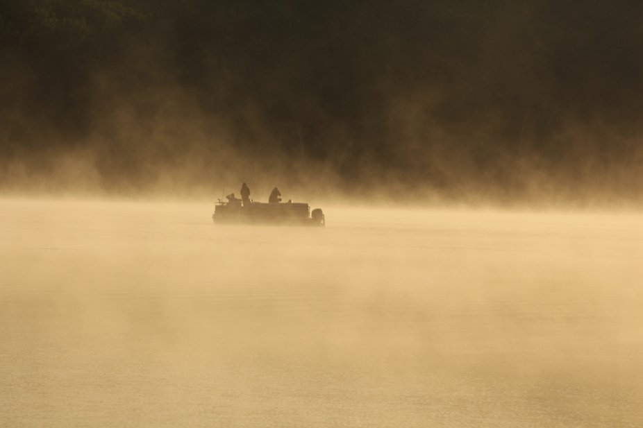 Two Fisherman enjoying the calm water. sunrise, hot humid morning, mid July 2019.  Clear Lake, On...