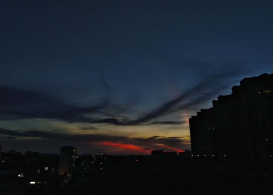 An almost surreal sky transcends a descending darkness over the city. Somewhere in Hyderabad.