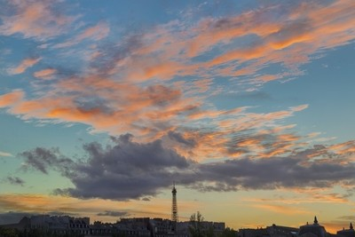 Pink and orange clouds over the Eiffel Tower at sunset