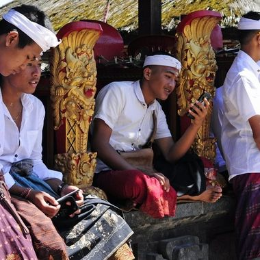 Even in the oldest village of Bali, Bayung Gede, kids are on their phones.
