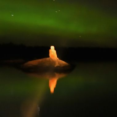 The Rainy Lake Mermaid enjoying the Northern Lights.