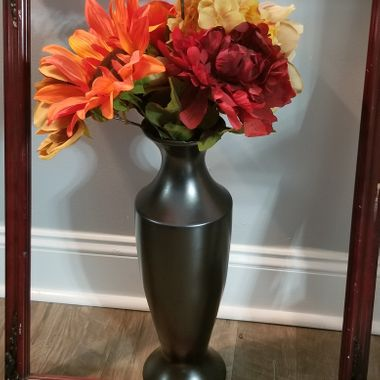 I went over to my cousin's house and she had a frame leaning up against a wall and she just sat a vase behind it with the flowers taken out. She said this is  Her 3-D art.