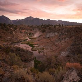 Post sunset over the hot springs of Mammoth region in the Eastern Sierras of California.  You can see the steam coming out of the spring...and th...