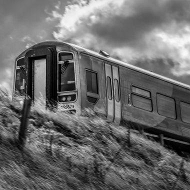A train speeding along the coastal railway at Colwyn Bay