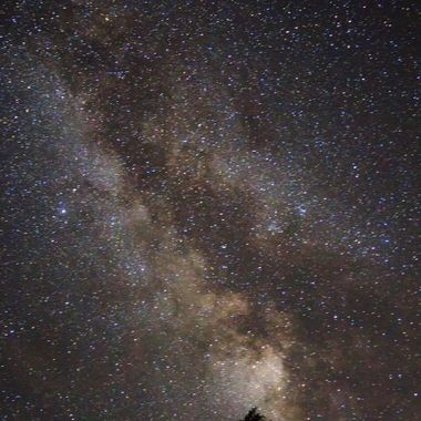 milky way in the sky in the back of the cabin