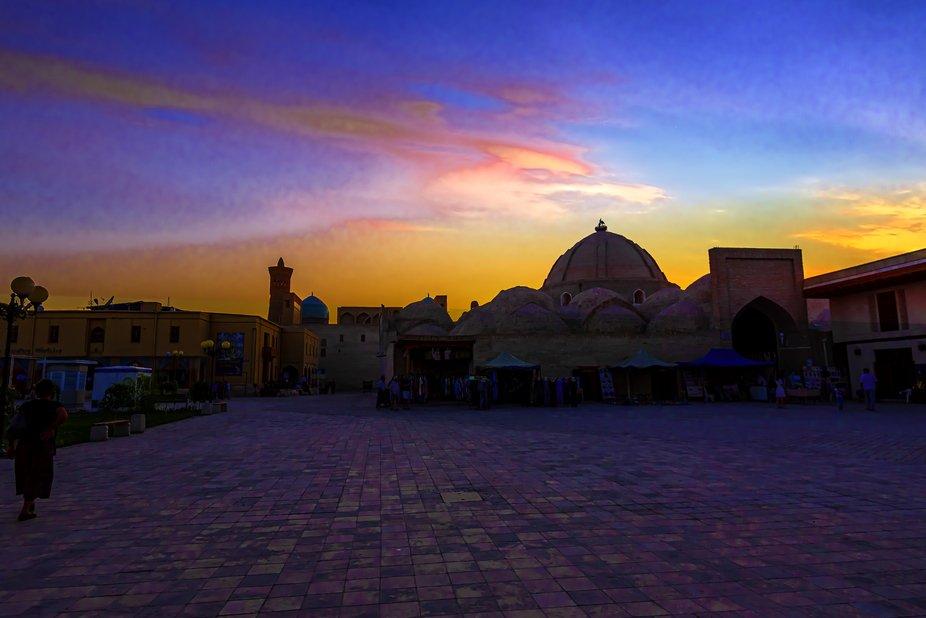 Setting sun over the monuments of Bukhara in Uzbekistan