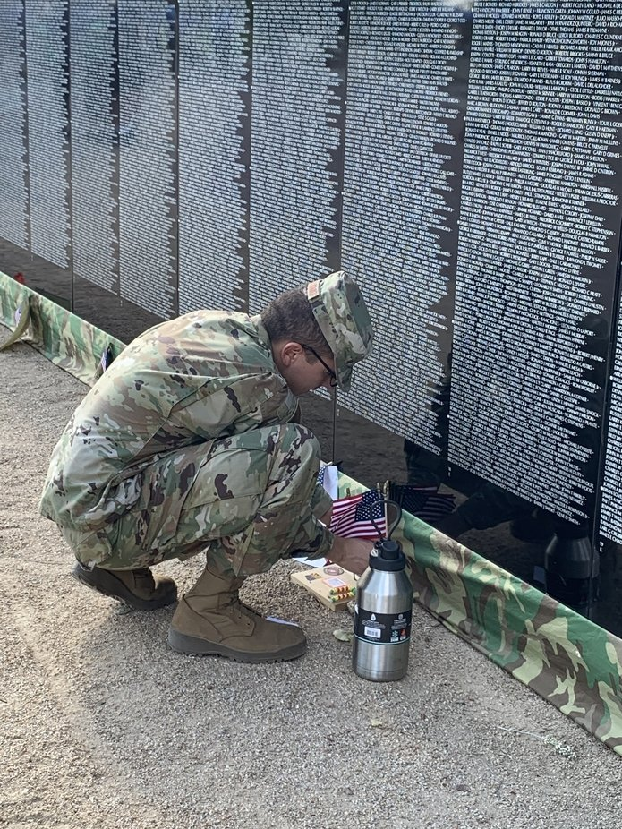 Airman fixes flags at the moving wall