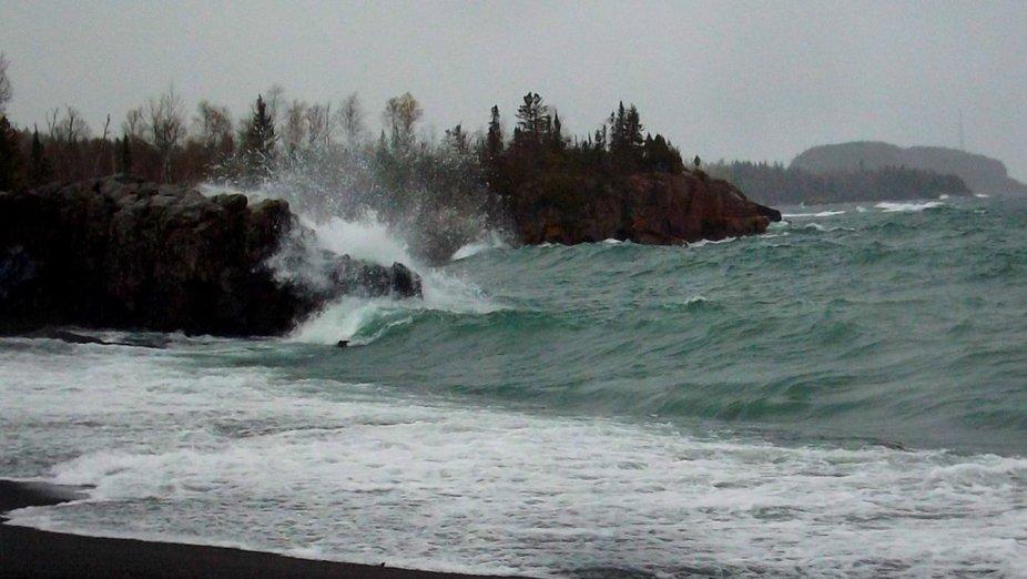 A wave splattering on a rock.