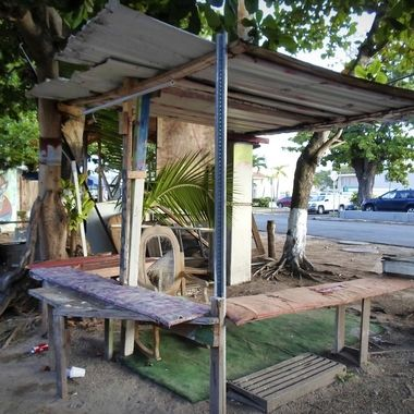 This is a very basic street vendor shack, it looks like they used found materials to make it.