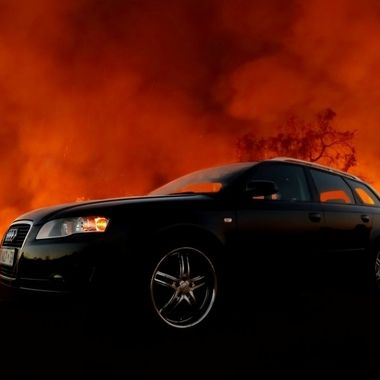 Audi with Fire Backdrop