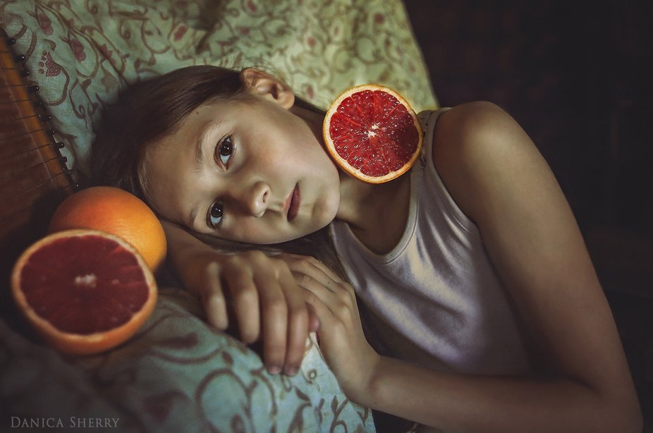 Portrait of my ten year old daughter, with her favourite fruit