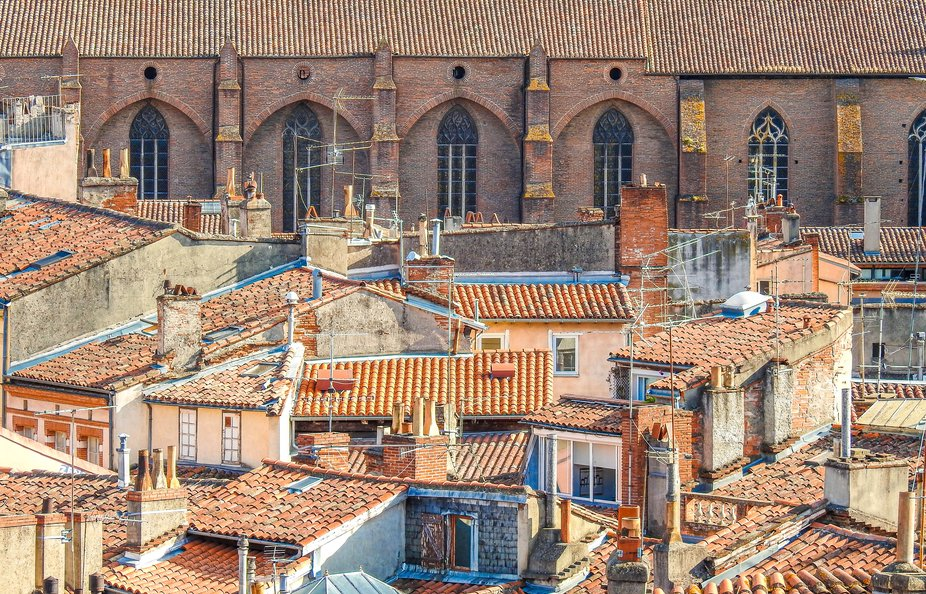 Tiled rooftops of Toulouse with the famous traditional orange brick architecture stretching benea...