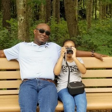 The child was enjoying a day at the bird park with her grandfather.