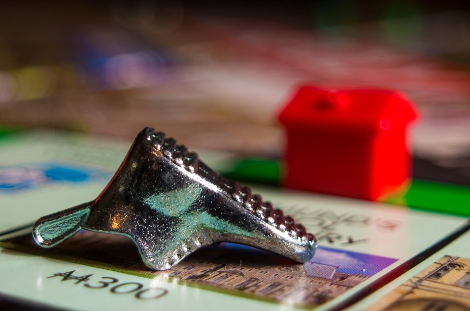 A macro photo of the shoe counter turned over from bankruptcy in a game of monopoly.