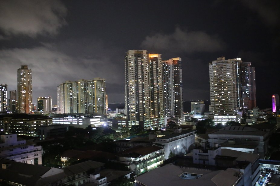 Manila, and Manila Bay as seen from the 16th floor of the Hotel Pearl Manila on the evening  Sept...