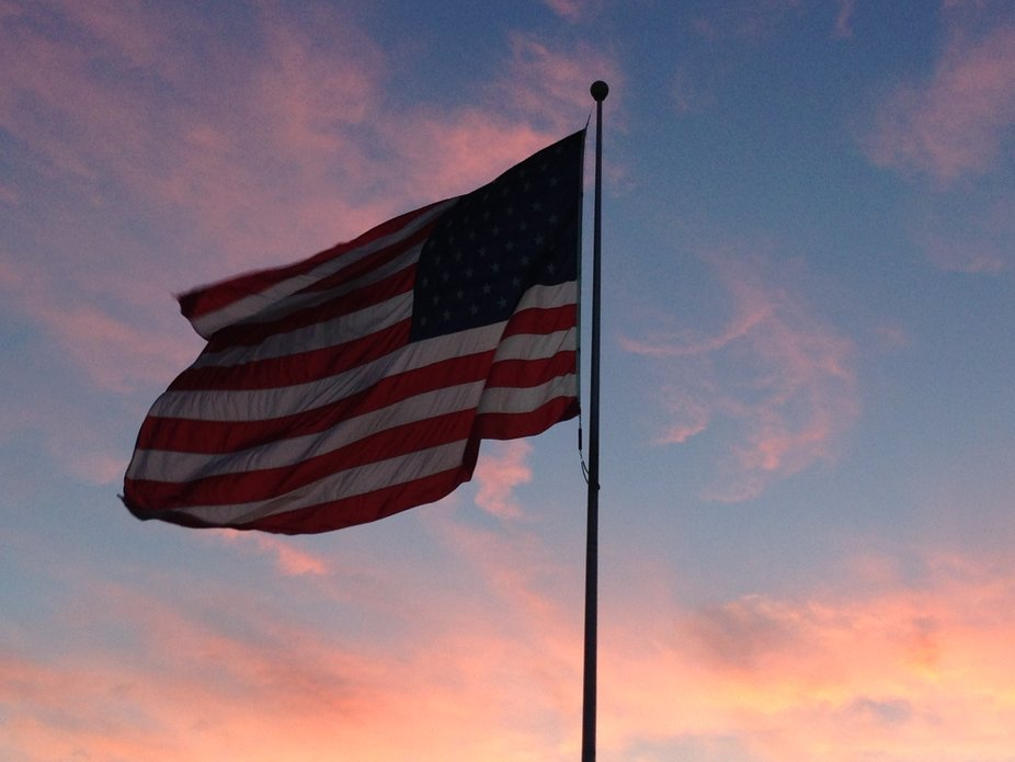 Beautiful sunset as the flag flows in the breeze