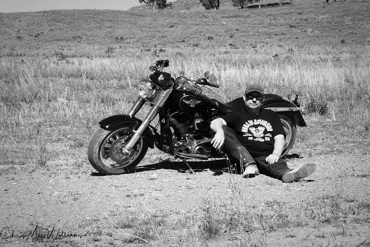 A photo of a mate and his Fatboy in country NSW Australia