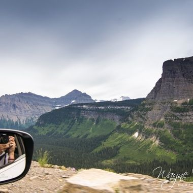 From the car and on the go... the photographer at work in the rear view side mirror.