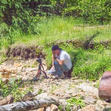 I don't do photos of me very often, but the comedian (my girlfriend) had the other camera and was snapping pictures of me while I was setting up and taking pictures of a log home that was down in a creek. I shot over a hundred frames of this particular log home from the 1800's in a ghost town near Wise River, MT.  Many of my photos are for sale, please click over to my photography store and take a peek. I have something for just about anyone who loves nature.