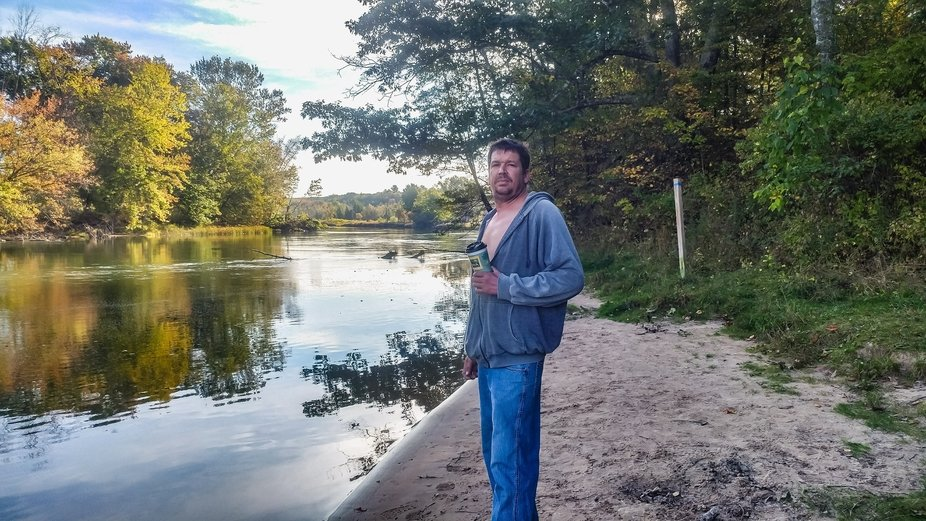 Beautiful Autumn morning.                    My boyfriend standing along the Manistee River.
